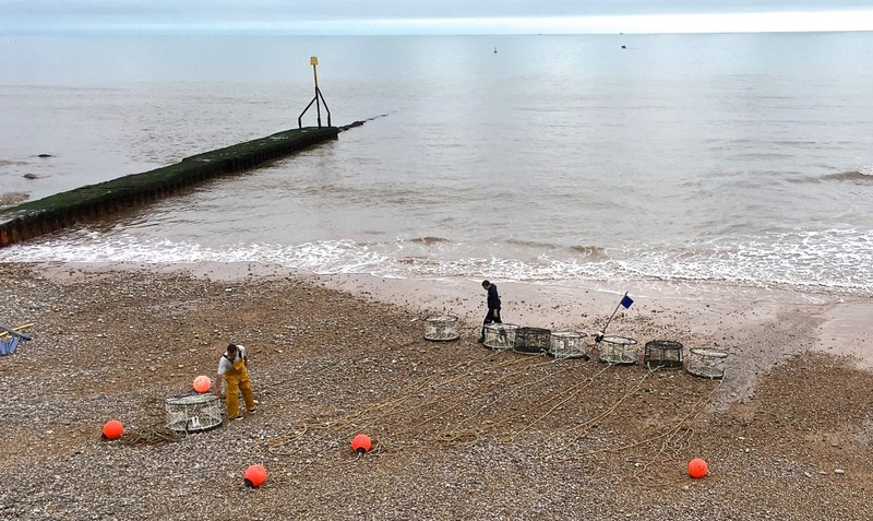 Fisherman on Sidmouth Beach