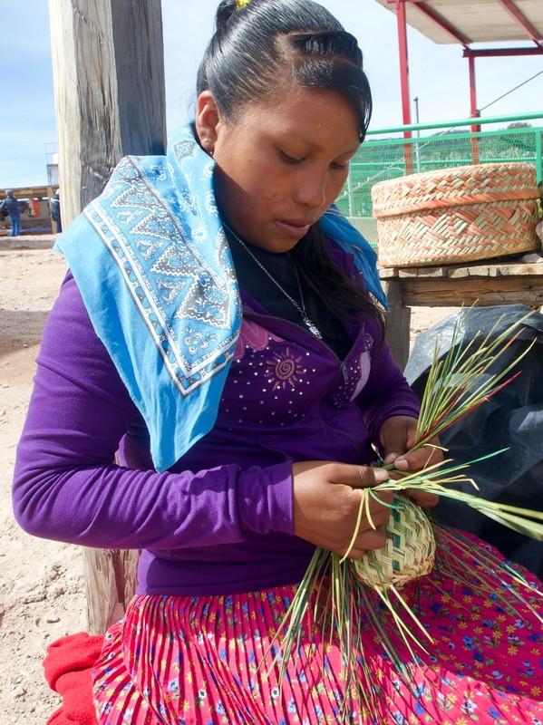 Raramuri girl or Tarahumara girl weaving a basket