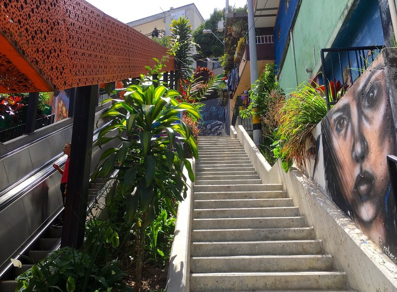 Newish escalator next to old stairs in Comuna 13