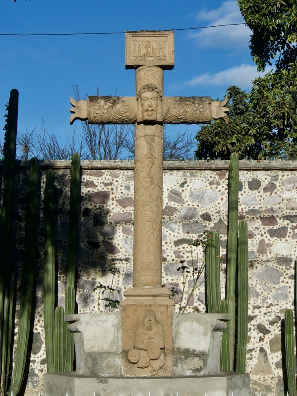 Cross from the time of the Conquistador, with some images such as flower to attract the locals