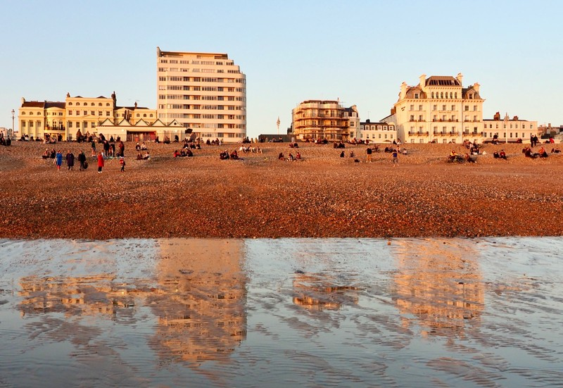 Reflection in the wet sand of Hove beach at low tide