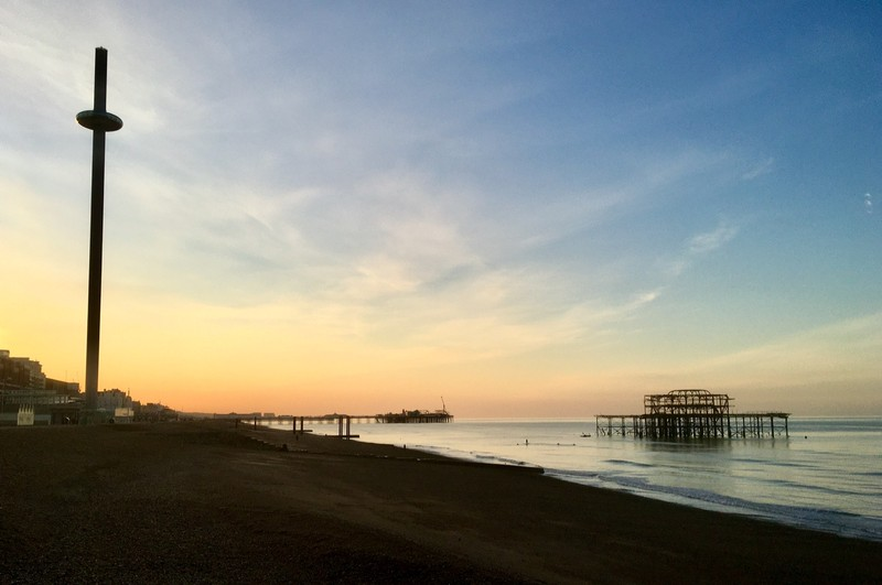 The West Pier and Brighton Pier at sunrise