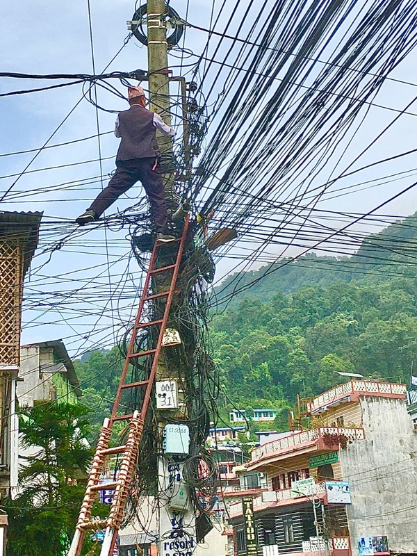 Electric work in Pokhara. The ladder looks dodgy too