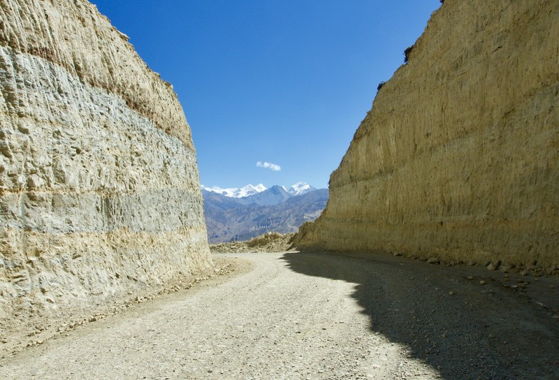 Road cut between the mountain side