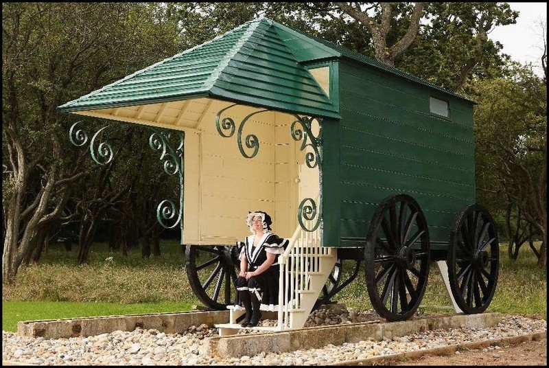Queen Victoria's bathing machine with a lady in period bathing costumes (photo from internet)