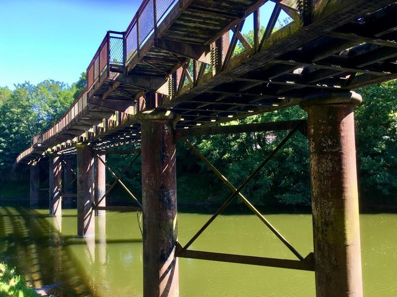 Old industrial bridge across the river Wye