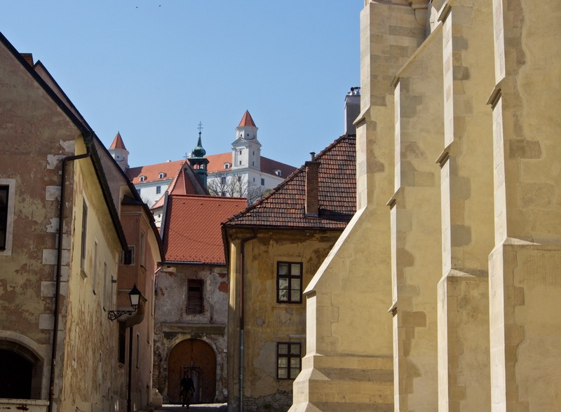 Old town backstreet with castle in the background