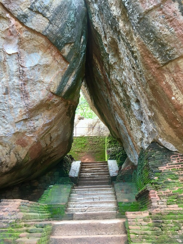 Starting the climb up to the top, going through gate made of boulders