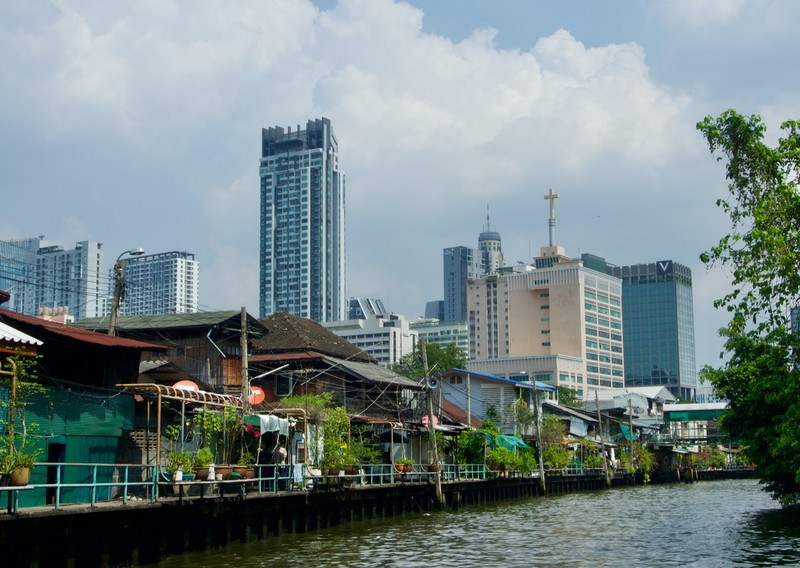 Mixed of old and new Bangkok on one of many canals