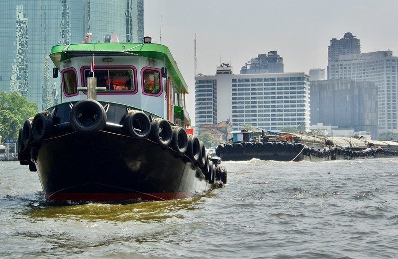 Tug pulling barges on the river Phraya, a common sight