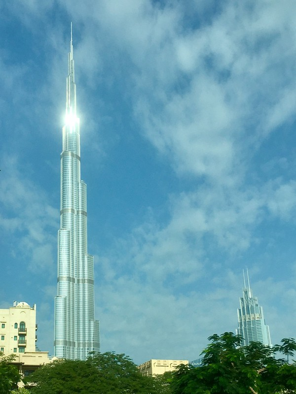 View from taxi on our way to stadium with light shining on Burj Khalifa