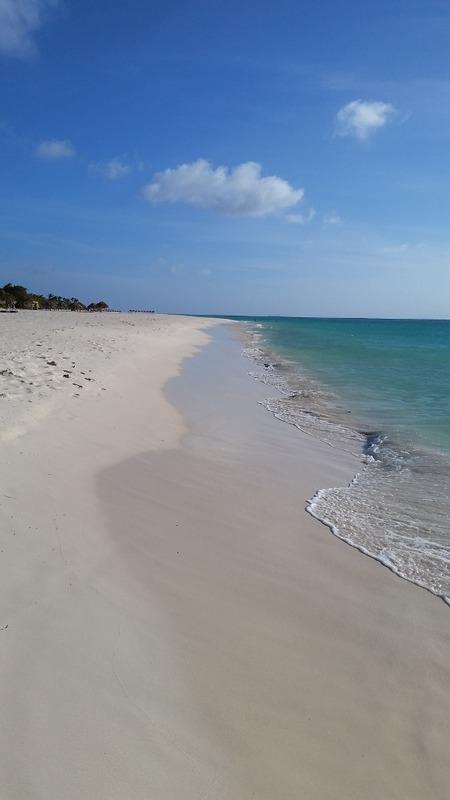 White sand beach  by the resort