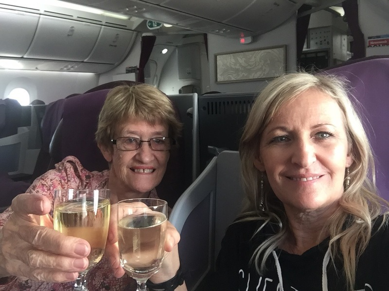 On the plane celebrating with some champagne