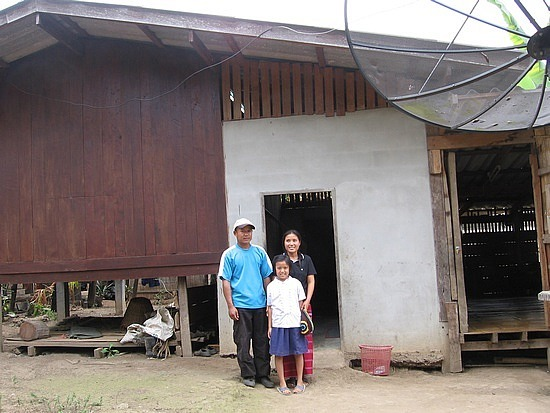 Mum, Dad & Kam outside their home