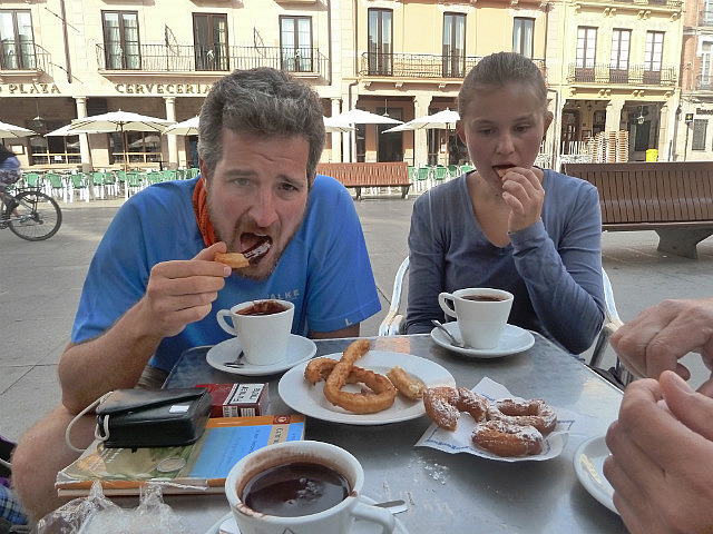 Eating churros dunked in chocolate in Astorga
