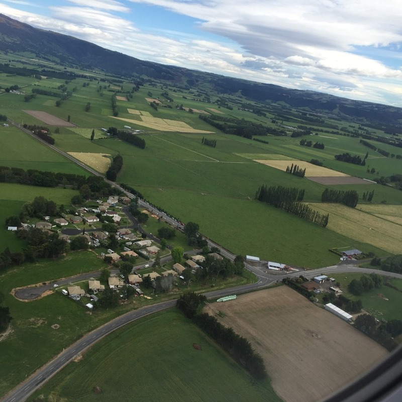 Green countryside taking off out of Dunedin