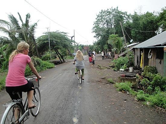 Riding through village