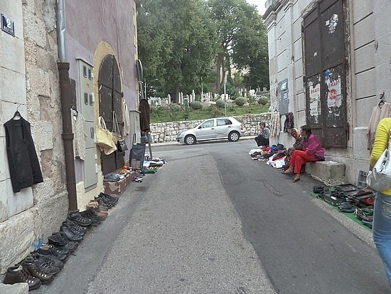Locals in alley selling second hand clothes