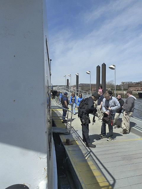 Coastguard with machine guns searching bags
