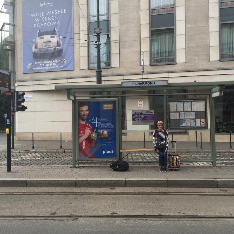 Mum at the tram stop in Krakow