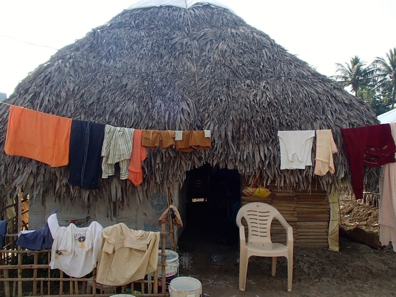Thatched roof and washing