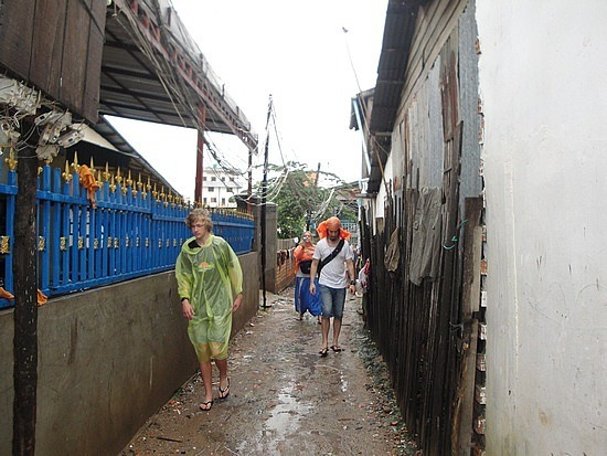 Wading through mud to get to a slum