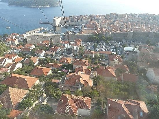 Over tops of houses on the hillside