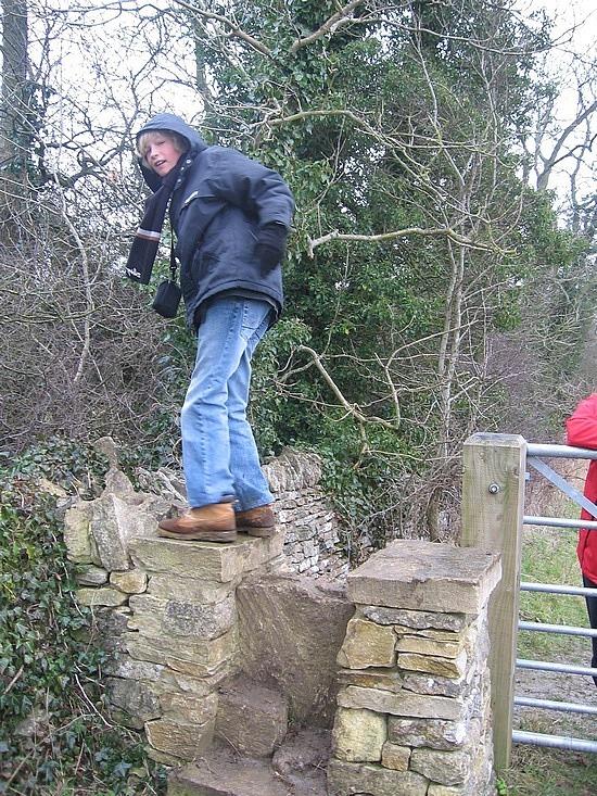 Nath climbing a stile