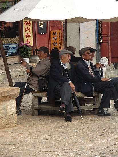 Old men watching life in the square