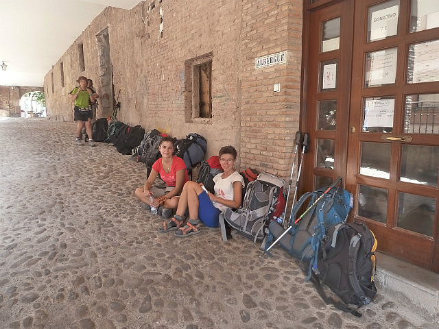 Lined up with our bags outsidethe Albergue doors