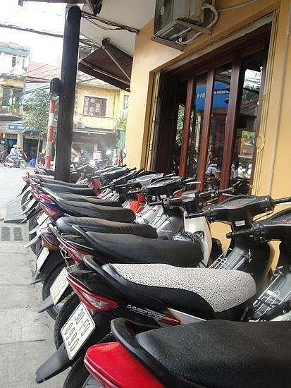 Motorbikes parked on the footpath