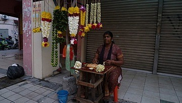 Seller opposite Hindu Temple