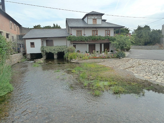 Stream flowing under a house