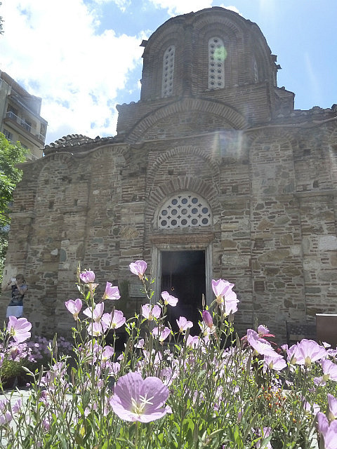 Poppies and old church