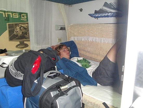 Nath in our soft sleeper berth surrounded by lugga