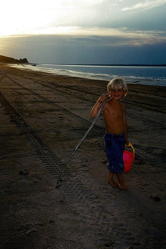 Nath on the beach playing at sunset