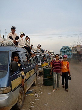 People on roofs of cars