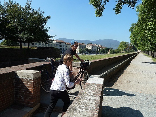 Carrying our bikes up on to the city walls
