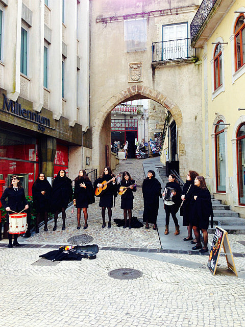University students singing  in the old town