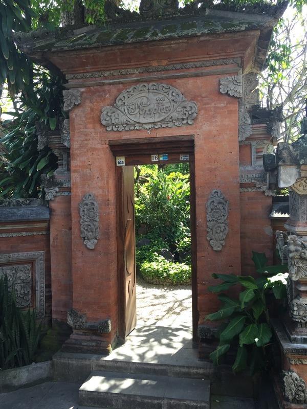 Gardens hidden behind imposing archways