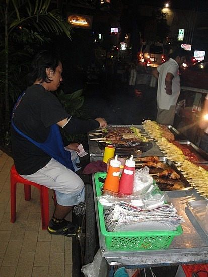 Our dinner being cooked - street stall Soi 11