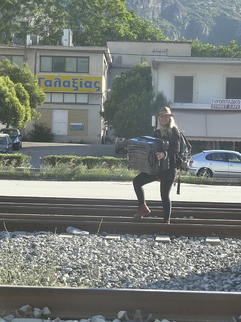 Carrying our suitcases across the railway tracks