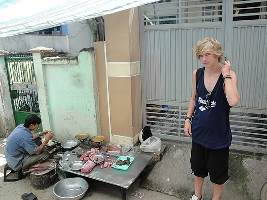 Nathan next to the meat seller at the front o