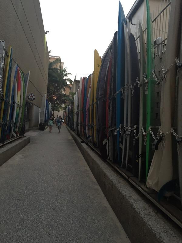 Walking down surfboard alley to Waikiki Beach