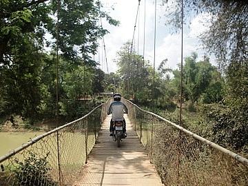 Moto driver going over the suspension bridge