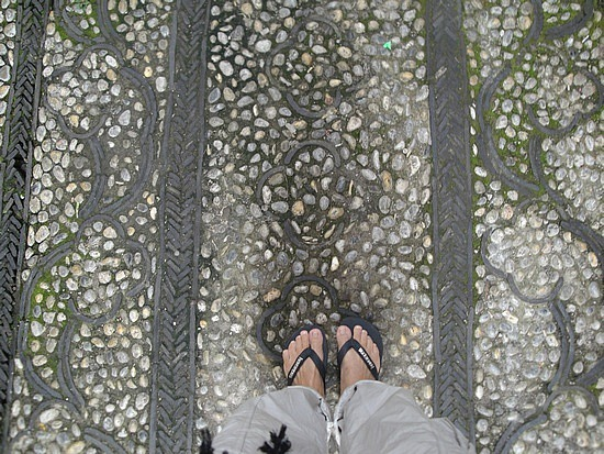 Looking at my feet on wood inlaid decoration