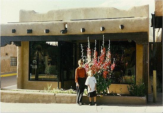 Mum & Michael by a flowering bush