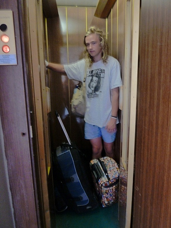 Nathan in the little lift leaving our hostel