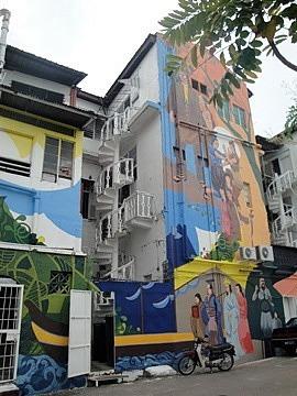 Steep winding staircase inside painted buildings