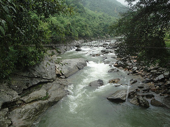 River at bottom of valley
